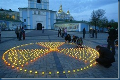 People light candles placed in the form radioactive symbol in Kiev, Ukraine