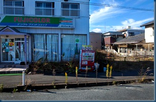 Earthquake damaged local store lies deserted in the Zone of Exclusion