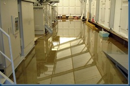 Credit: Tokyo Electric Power Co (TEPCO): radioactive water on the floor inside the building of a water treatment facility at TEPCO's Fukushima Daiichi nuclear plant.